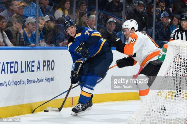 Beau Bennett of the St Louis Blues controls the puck as Robert Hagg of the Philadelphia Flyers defends at Scottrade Center on November 2 2017 in St...