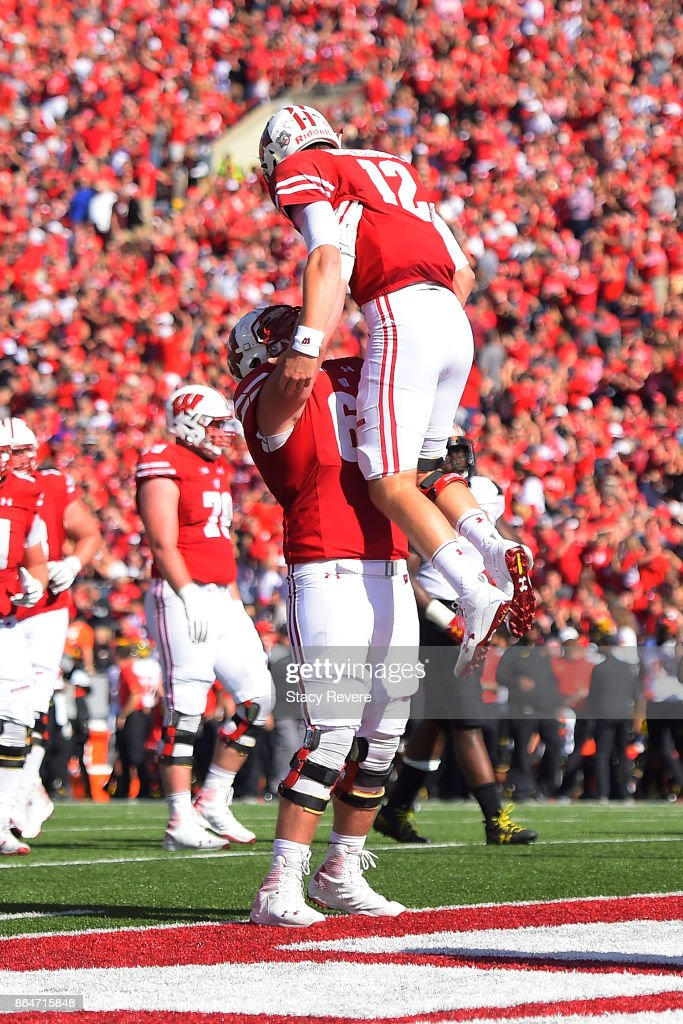 Beau Benzschawel #66 of the Wisconsin Badgers celebrates a touchdown with Alex Hornibrook #12 during a game against the Maryland Terrapins at Camp Randall Stadium on October 21, 2017 in Madison, Wisconsin.