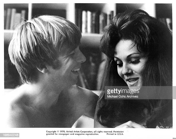 Beau Bridges lies in bed with Marki Bey in a scene from the film 'The Landlord' 1970