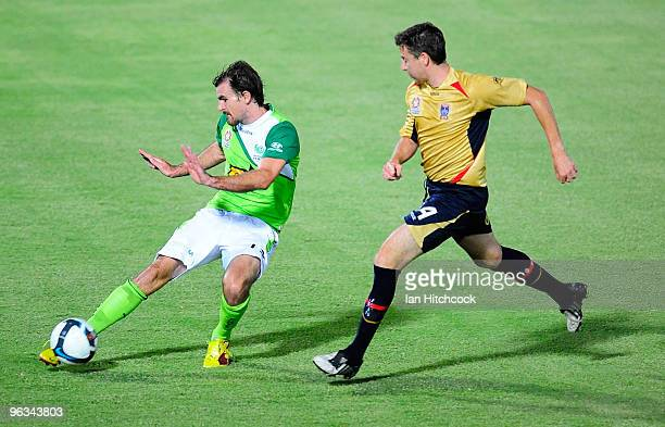 Beau Busch of the Fury clears the bal away from Michael Bridges of the Jets during the round 25 ALeague match between North Queensland Fury and the...