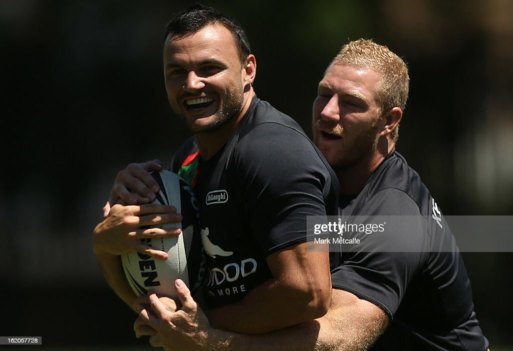 Beau Champion is tackled by Michael Crocker during a South Sydney Rabbitohs NRL training session at the National Centre for Indigenous Excellence on February 19, 2013 in Sydney, Australia.