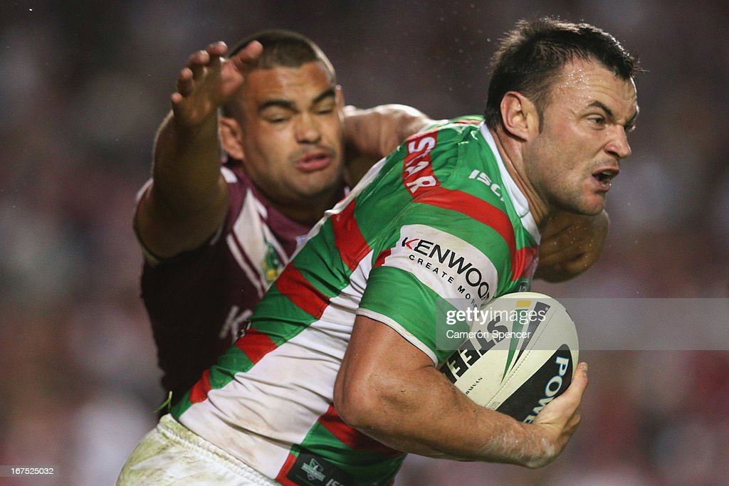 Beau Championof the Rabbitohs is tackled during the round seven NRL match between the Manly Sea Eagles and the South Sydney Rabbitohs at Brookvale Oval on April 26, 2013 in Sydney, Australia.