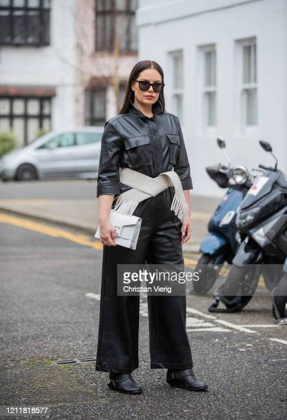Beau Dunn is seen wearing black leather overall, belt, white bag on March 04, 2020 in London, England.