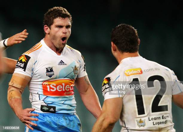 Beau Falloon of the Titans celebrates with Mark Minichiello after scoring a try during the round 21 NRL match between the Sydney Roosters and the...