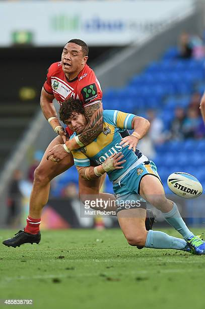 Beau Falloon of the Titans is tackled by Tyson Frizell of the Dragons during the round 25 NRL match between the Gold Coast Titans and the St George...