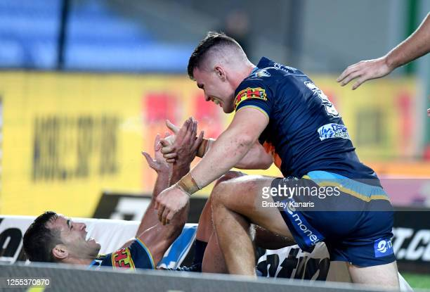 Beau Fermor of the Titans celebrates with team mate Corey Thompson after scoring a try during the round nine NRL match between the Gold Coast Titans...
