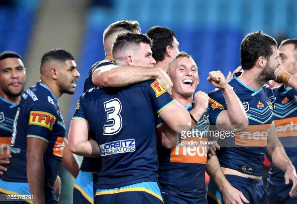 Beau Fermor of the Titans is congratulated by team mates after scoring a try during the round nine NRL match between the Gold Coast Titans and the...