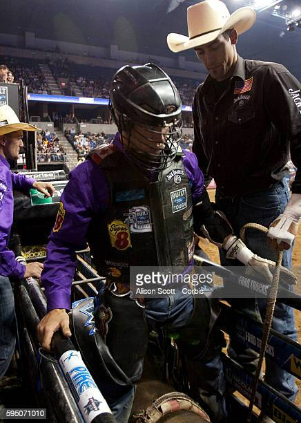 Beau Hill helps Canadian rider Tyler Thomson get ready to ride his bull My Space Thomson was bucked off before the eight second whistle The two day...