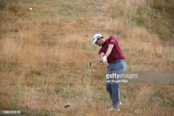 Beau Hossler of the United States plays his second shot on the 1st hole while practicing during previews to the 147th Open Championship at Carnoustie...