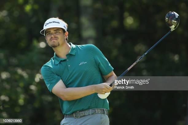 Beau Hossler of the United States plays his shot from the 18th tee during round two of the Dell Technologies Championship at TPC Boston on September...