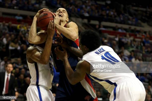 Beau Levesque of the St Mary's Gaels goes up for a shot attempt in the seocnd half against Geron Johnson and Tarik Black of the Memphis Tigers during...