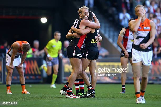 Beau Maister Nathan Wright and Sam Gilbert of the Saints celebrate winning the round two AFL match between the St Kilda Saints and the Greater...