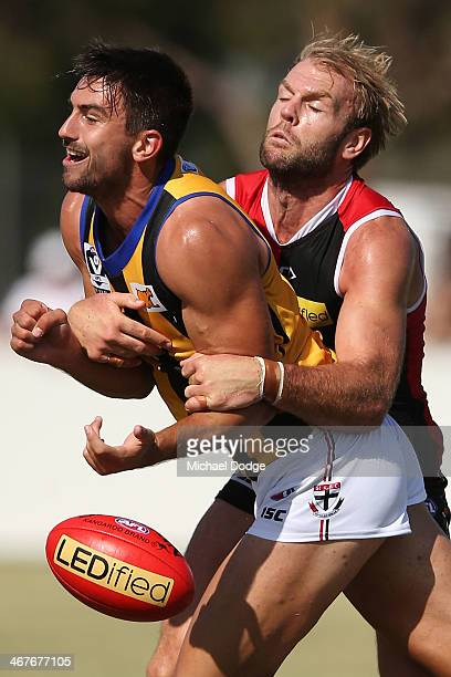Beau Maister tackles Billy Longer during a St Kilda Saints AFL intraclub match at Linen House Oval on February 8 2014 in Melbourne Australia
