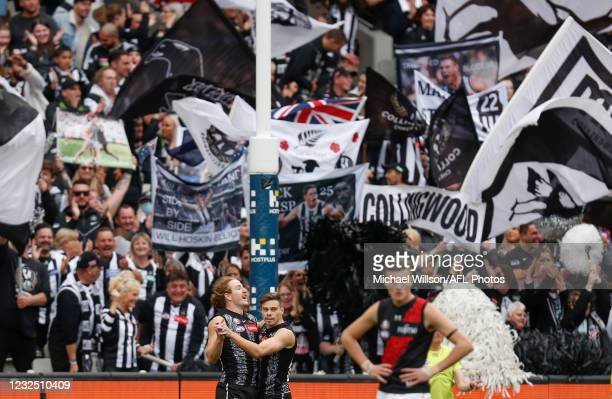 Beau McCreery and Josh Thomas of the Magpies celebrate during the 2021 AFL Round 06 match between the Collingwood Magpies and the Essendon Bombers at...