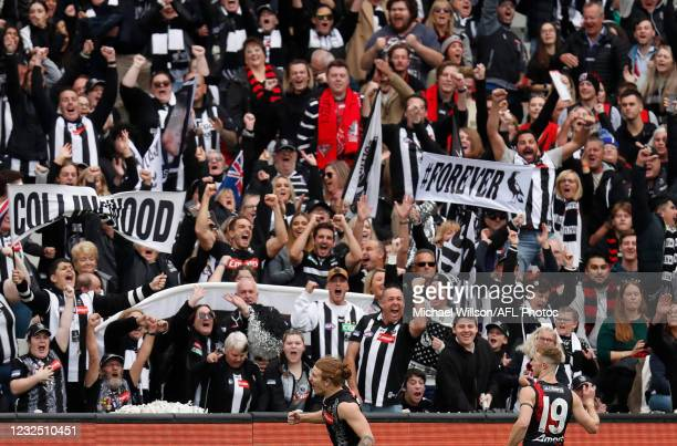 Beau McCreery of the Magpies celebrates a goal during the 2021 AFL Round 06 match between the Collingwood Magpies and the Essendon Bombers at the...