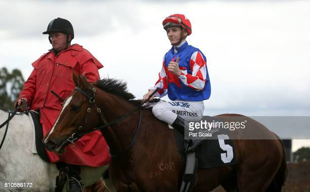 Beau Mertens returns to scale on Schism after winning race 3 during Melbourne Racing at Flemington Racecourse on July 8 2017 in Melbourne Australia
