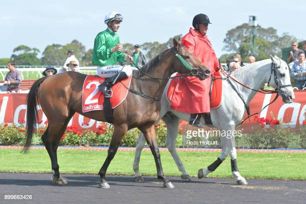 Beau Mertens returns to the mounting yard on Orient Line after winning the Ladbrokes Up For The Challenge Handicap at Ladbrokes Park Hillside...