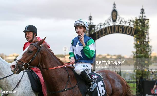 Beau Mertens returns to the mounting yard on Stormsabrewing after winning True Version Handicapat Flemington Racecourse on May 06 2017 in Flemington...