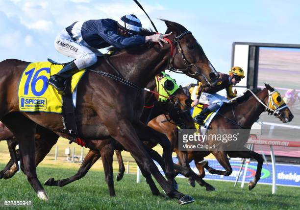 Beau Mertens riding Diamond Grace wins Race 5 during Melbourne Racing at Sandown Hillside on July 26 2017 in Melbourne Australia