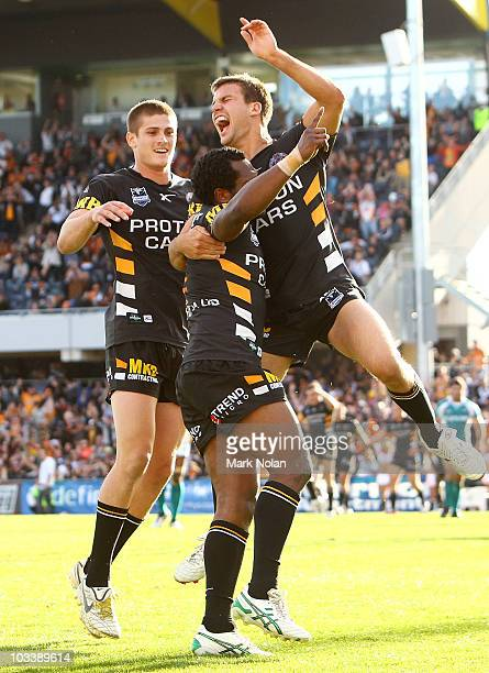 Beau Ryan and Blake Ayshford of the Tigers celebrate a try by team mate Robert Lui during the round 23 NRL match between the Wests Tigers and the...