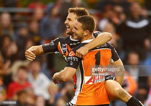 Beau Ryan and Tim Moltzen of the Tigers celebrate a try by Moltzen during the round 12 NRL match between the Wests Tigers and the North Queensland...