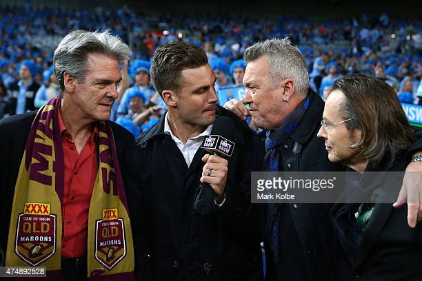 Beau Ryan interviews members of Cold Chisel Don Walker Jimmy Barns and Phil Small during game one of the State of Origin series between the New South...