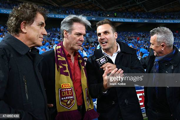 Beau Ryan interviews members of Cold Chisel Ian Moss Don Walker and Jimmy Barns during game one of the State of Origin series between the New South...