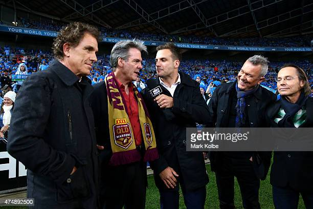 Beau Ryan interviews members of Cold Chisel Ian Moss Don Walker Jimmy Barns and Phil Small during game one of the State of Origin series between the...