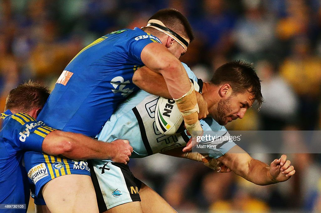 Beau Ryan of the Sharks is tackled during the round nine NRL match between the Parramatta Eels and the Cronulla-Sutherland Sharks at Pirtek Stadium on May 12, 2014 in Sydney, Australia.