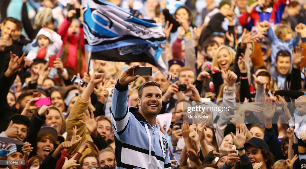 Beau Ryan of the Sharks takes a 'selfie' with sharks fans after the round 18 NRL match between the Cronulla Sharks and the Newcastle Knights at Remondis Stadium on July 13, 2014 in Sydney, Australia.