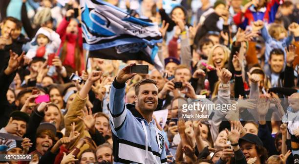 Beau Ryan of the Sharks takes a 'selfie' with sharks fans after the round 18 NRL match between the Cronulla Sharks and the Newcastle Knights at...