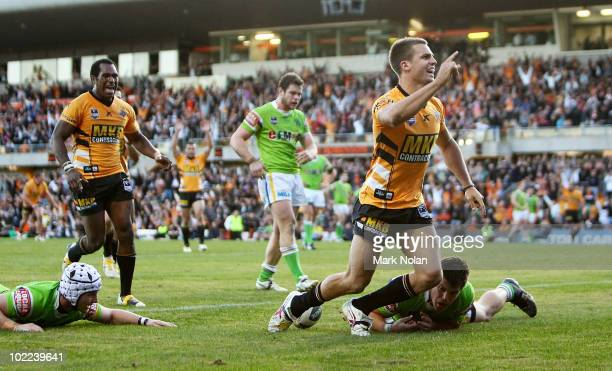 Beau Ryan of the Tigers celebrates after scoring during the round 15 NRL match between the Wests Tigers and the Canberra Raiders at Leichhardt Oval...