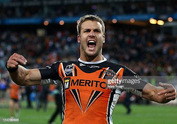 Beau Ryan of the Tigers celebrates winning the NRL 1st Qualifying Final match between the Wests Tigers and the St George Illawarra Dragons at ANZ...