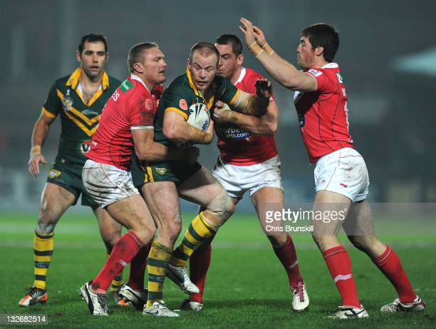 Beau Scott of Australia runs into the Wales defence during the Four Nations match between Wales and Australia at The Racecourse Ground on November 13...