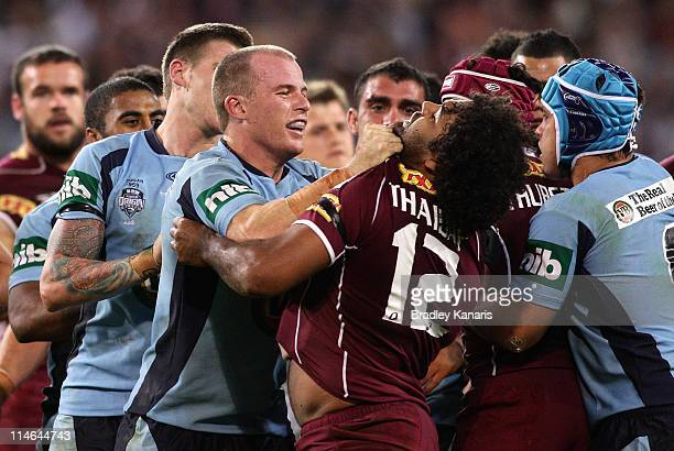 Beau Scott of the Blues and Sam Thaiday of the Maroons are involved in an all in brawl during game one of the ARL State of Origin series between the...