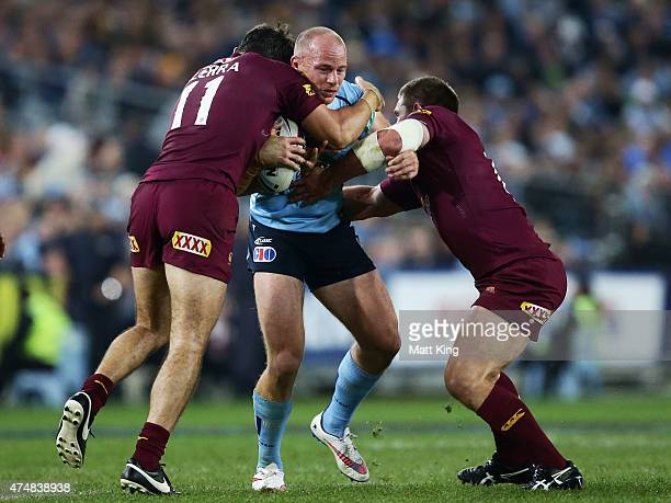 Beau Scott of the Blues is tackled during game one of the State of Origin series between the New South Wales Blues and the Queensland Maroons at ANZ...