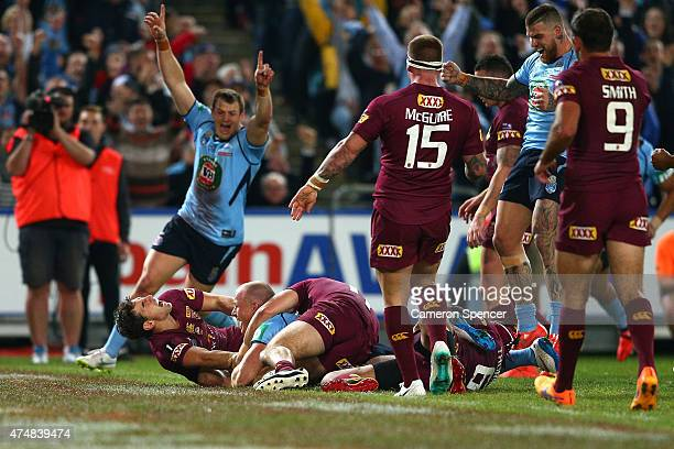 Beau Scott of the Blues scores s try during game one of the State of Origin series between the New South Wales Blues and the Queensland Maroons at...