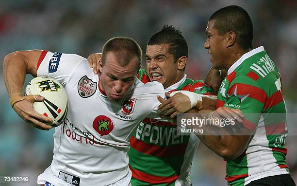 Beau Scott of the Dragons takes on the Rabbitohs defence during the NRL Charity Shield match between the South Sydney Rabbitohs and the St...