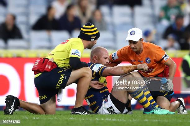 Beau Scott of the Eels is assisted from the field during the round 11 Parramatta Eels and the New Zealand Warriors at ANZ Stadium on May 18 2018 in...