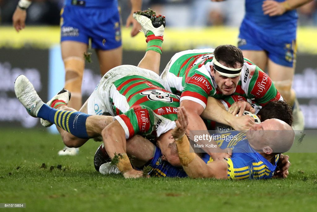 Beau Scott of the Eels is tackled by Jason Clark and Dave Tyrrell of the Rabbitohs during the round 26 NRL match between the Parramatta Eels and the South Sydney Rabbitohs at ANZ Stadium on September 1, 2017 in Sydney, Australia.