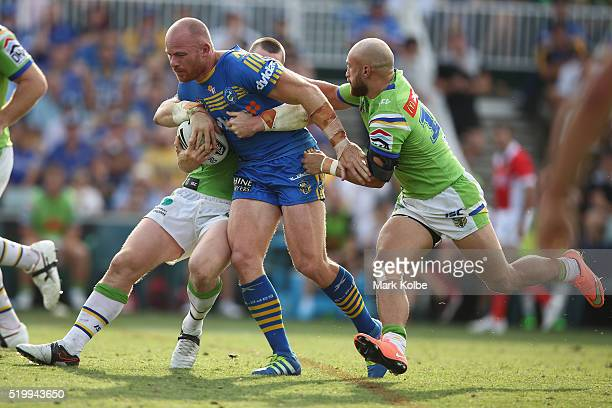 Beau Scott of the Eels is tackled during the round six NRL match between the Parramatta Eels and the Canberra Raiders at Pirtek Stadium on April 9...