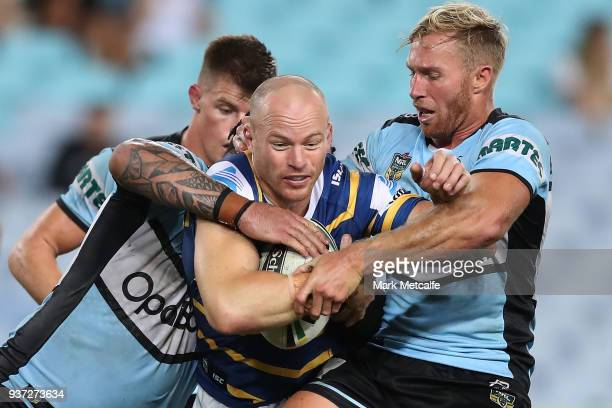 Beau Scott of the Eels is tackled during the round three NRL match between the Parramatta Eels and the Cronulla Sharks at ANZ Stadium on March 24...