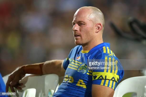 Beau Scott of the Eels looks on from the bench during the round 14 NRL match between the Parramatta Eels and the North Queensland Cowboys at TIO...