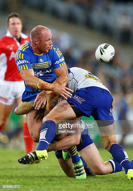 Beau Scott of the Eels offloads during the round nine NRL match between the Parramatta Eels and the Canterbury Bulldogs at ANZ Stadium on April 29...