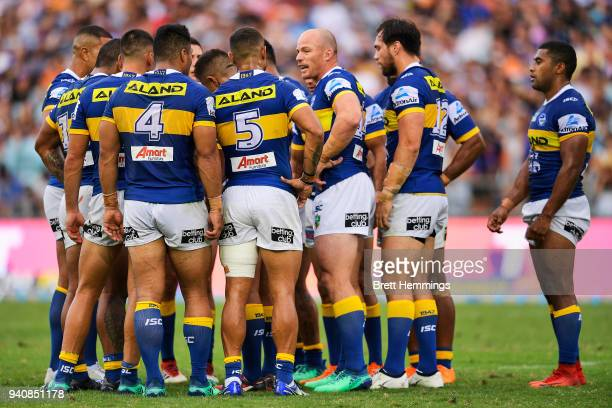 Beau Scott of the Eels speaks with team mates during the round four NRL match between the Wests Tigers and the Parramatta Eels at ANZ Stadium on...