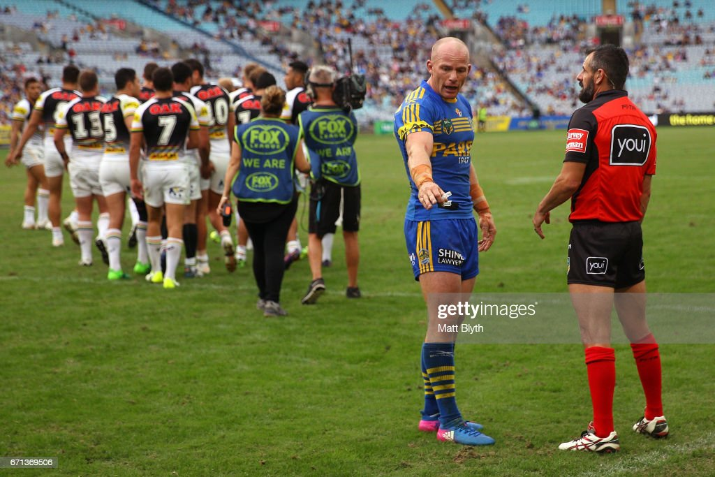 Beau Scott of the Eels talks to referee Gavin Badger during the round eight NRL match between the Parramatta Eels and the Penrith Panthers at ANZ Stadium on April 22, 2017 in Sydney, Australia.
