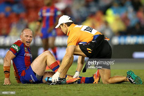 Beau Scott of the Knights is carried off injured during the round five NRL match between the Newcastle Knights and the St George Illawarra Dragons at...