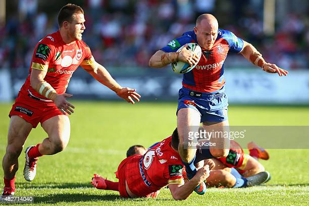 Beau Scott of the Knights is tackled during the round 21 NRL match between the St George Illawarra Dragons and the Newcastle Knights at WIN Jubilee...
