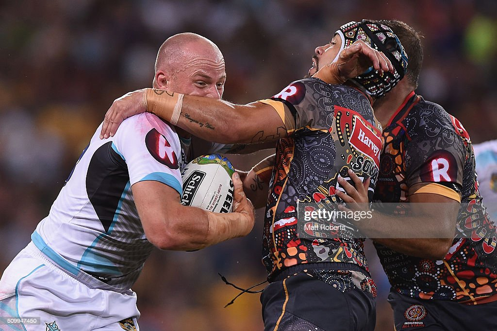 Beau Scott of the World All Stars is tackled by Jamie Soward of the Indigenous All Stars during the NRL match between the Indigenous All-Stars and the World All-Stars at Suncorp Stadium on February 13, 2016 in Brisbane, Australia.