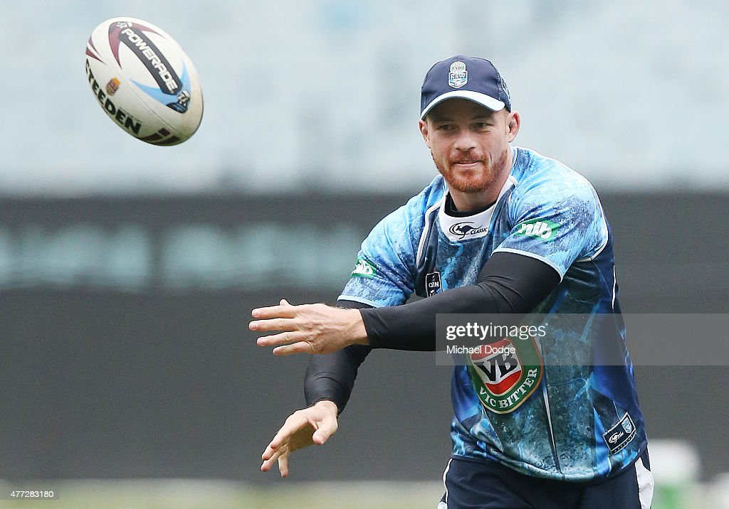 Beau Scott offloads the ball during a New South Wales Blues State of Origin training session at the Melbourne Cricket Ground on June 16, 2015 in Melbourne, Australia.